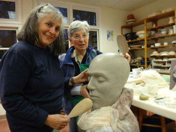 Anna Koloseike (L) and Susan Wilson (R) working in the art studio