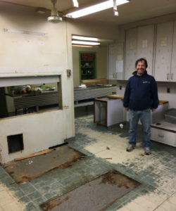 Facilities Manager Jerry McCourt inspects ongoing renovations at Main House